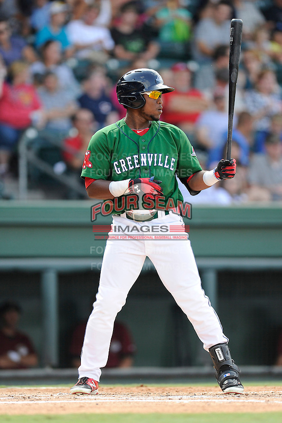 Right fielder Franklin Guzman (10) of the Greenville Drive bats in a game against the Savannah Sand Gnats on Sunday, August 24, 2014, at Fluor Field at the West End in Greenville, South Carolina. Greenville won, 8-5. (Tom Priddy/Four Seam Images)