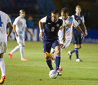 The USA's Clint Dempsey (8) dribbles the ball past Guatemala's (11) Jose Manuel Contreras as the United States played Guatemala at Estadio Mateo Flores in Guatemala City, Guatemala in a World Cup Qualifier on Tue. June 12, 2012.