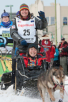 Jan Steves and team leave the ceremonial start line with an Iditarider at 4th Avenue and D Street in downtown Anchorage, Alaska on Saturday, March 5th during the 2016 Iditarod race. Photo by Joshua Borough/SchultzPhoto.com