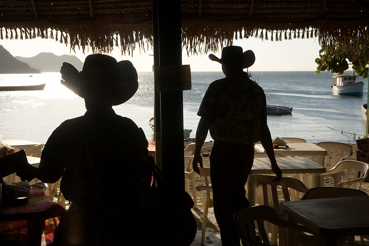 TAGANGA - JANUARY 13:  Waiters wearing straw hats work at a beachside restaurant in Taganga, Colombia on January 13, 2007. (Photo by Dennis Drenner/Aurora)