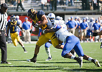 September 17, 2011:  California's Will Kapp rushes for more yardage against Presbyterian's defensive player during a game at AT&T Park, San Francisco, Ca   California Defeated Presbyterian 63 - 12