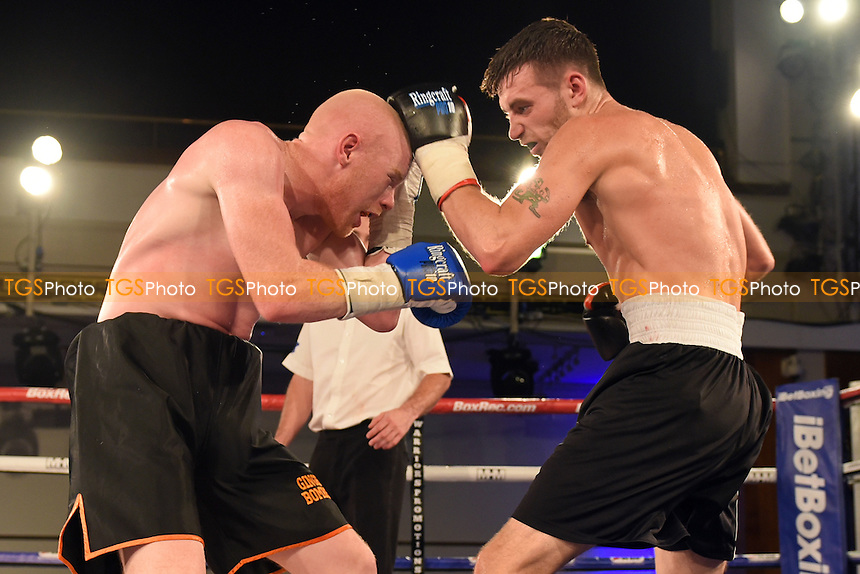 Tommy Tear (black/white shorts) defeats Ryan Hardy during a Boxing Show at the Camden Centre, Euston Road, England on 02/10/2015