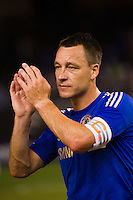 John Terry (26) of Chelsea FC salutes the fans after the match. Chelsea FC and Paris Saint-Germain played to a 1-1 tie during a 2012 Herbalife World Football Challenge match at Yankee Stadium in New York, NY, on July 22, 2012.