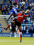 Leicester City v Barnsley<br /> 28.9.2013<br /> Sky Bet Championship<br /> Picture Shaun Flannery/Trevor Smith Photography<br /> Leicester's Wes Morgan beats Barnsley's Chris O'Grady.