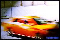 Streaking orange car on Mercer St.