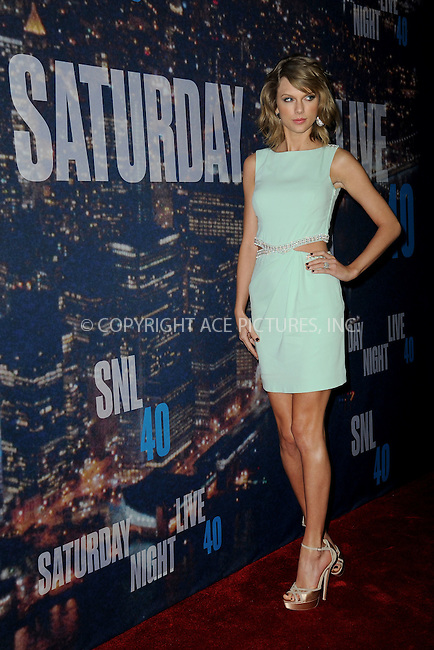 WWW.ACEPIXS.COM<br /> February 15, 2015 New York City<br /> <br /> <br /> Taylor Swift walking the red carpet at the SNL 40th Anniversary Special at 30 Rockefeller Plaza on February 15, 2015 in New York City.<br /> <br /> Please byline: Kristin Callahan/AcePictures<br /> <br /> ACEPIXS.COM<br /> <br /> Tel: (646) 769 0430<br /> e-mail: info@acepixs.com<br /> web: http://www.acepixs.com