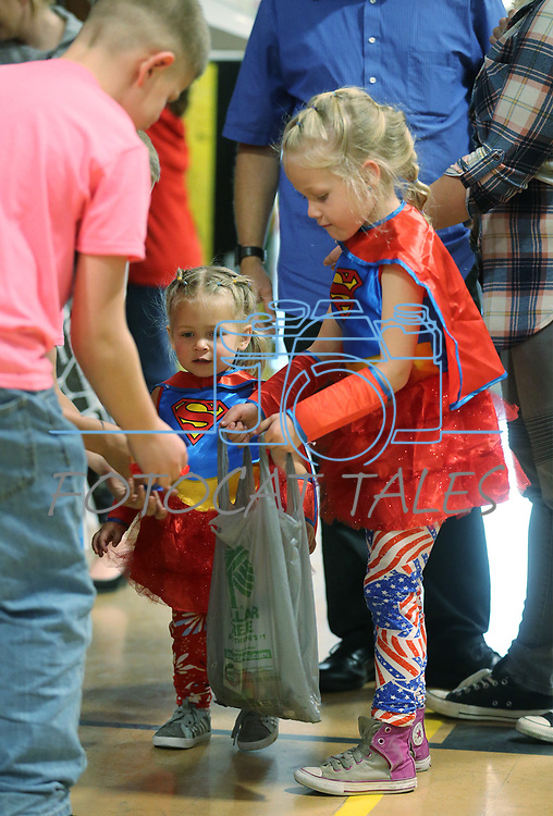 Regan and Cora Hardiman, 5 and 2, trick-or-treat during the Carson City Boo-nanza at the Community Center on Wednesday, Oct. 25, 2017. <br /> Photo by Cathleen Allison/Nevada Momentum