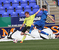 Adam Campbell crossing past Graeme Shinnie in the Inverness Caledonian Thistle v St Mirren Scottish Professional Football League Premiership match played at the Tulloch Caledonian Stadium, Inverness on 29.3.14.