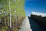 """Looking up an access path toward the overpass that carries the Park over the train tracks and connects the waterfront, or Shore, portion of the Park with the Meadows, the Grove, and the Valley portions.  At left are aspens that help provide the gateway from one """"zone"""" to another.  SAM's Olympic Sculpture Park, Seattle, WA."""