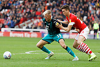 (L-R) Sam Surridge of Swansea City challenged by Aapo Halme of Barnsley during the Sky Bet Championship match between Barnsley and Swansea City at Oakwell Stadium, Barnsley, England, UK. Saturday 19 October 2019