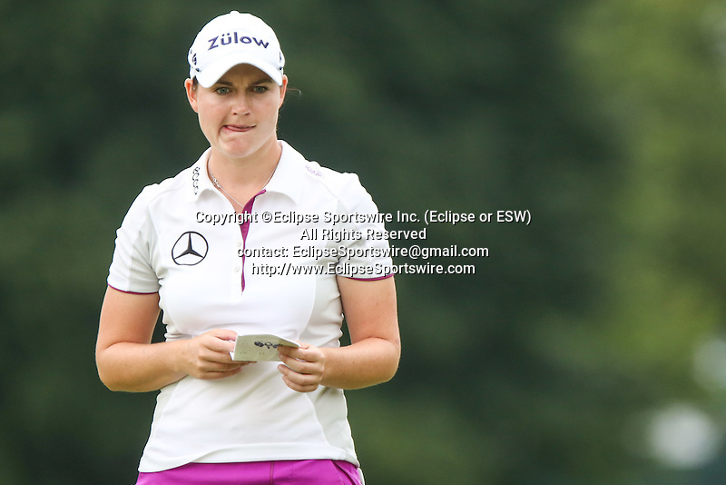 Caroline Masson reviews the 10th green at the LPGA Championship 2014 Sponsored By Wegmans at Monroe Golf Club in Pittsford, New York on August 16, 2014