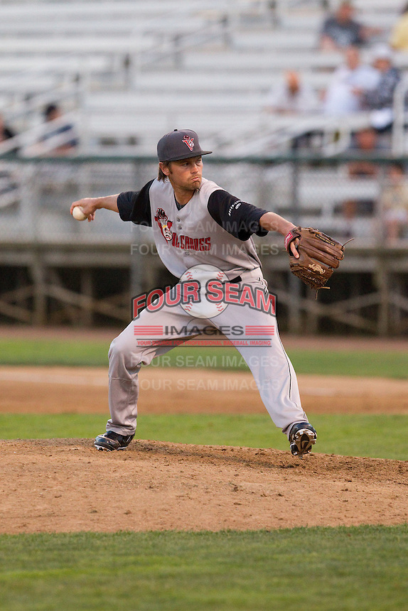 Kirk Singer #13 of the Salem-Keizer Volcanoes delivers a pitch during a game against the Everett AquaSox at Everett Memorial Stadium in Everett, Washington on July 14, 2014.  Salem-Keizer defeated Everett 6-4.  (Ronnie Allen/Four Seam Images)