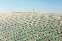 Chinese workers work on Terminal 3 Beijing International Airport in Beijing, China. Designed by British architect Lord Norman Foster.