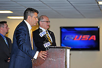 4 May 2012:  FIU Executive Director of Sports and Entertainment Pete Garcia (at podium) with University President Mark Rosenberg in the background, speaks at a press conference during which the FIU Golden Panthers, currently a member of the Sun Belt Conference, formally announced their acceptance of an invitation to join Conference USA for all sports starting July 1, 2013, at the FIU Stadium Club in Miami, Florida.