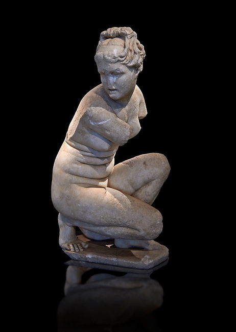 Crouching Aphrodite (Venus). 2nd Century  Roman Marble Statue from Marmol. Cordoba Archaeological Museum, Spain.<br /> This sculpture  is a variation on the Classic Hellanistic 3rd to Ist century BC style of Aphrodite crouching to bathe. Aphrodite crouches with her right knee close to the ground, turns her head to the right as if looking at somebody and, in most versions, reaches her right arm over to her left shoulder to cover her breasts.