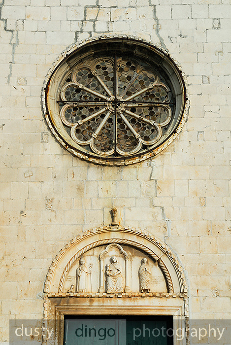 Rose window and portal of Church of Sveti Duje (Saint Dominic) Monastery. Trogir, Croatia