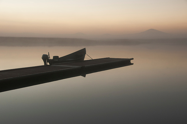 A fishing boat at dawn at Rocky Point, Klamath Lake, Oregon.