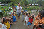Teacher Lodema Dela Cruz Doroteo sings a song with children in Santa Ines, an indigenous village in the Philippines. A graduate of Harris Memorial College, where she benefited from a scholarship from United Methodist Women, she is the first indigenous school teacher in her village.