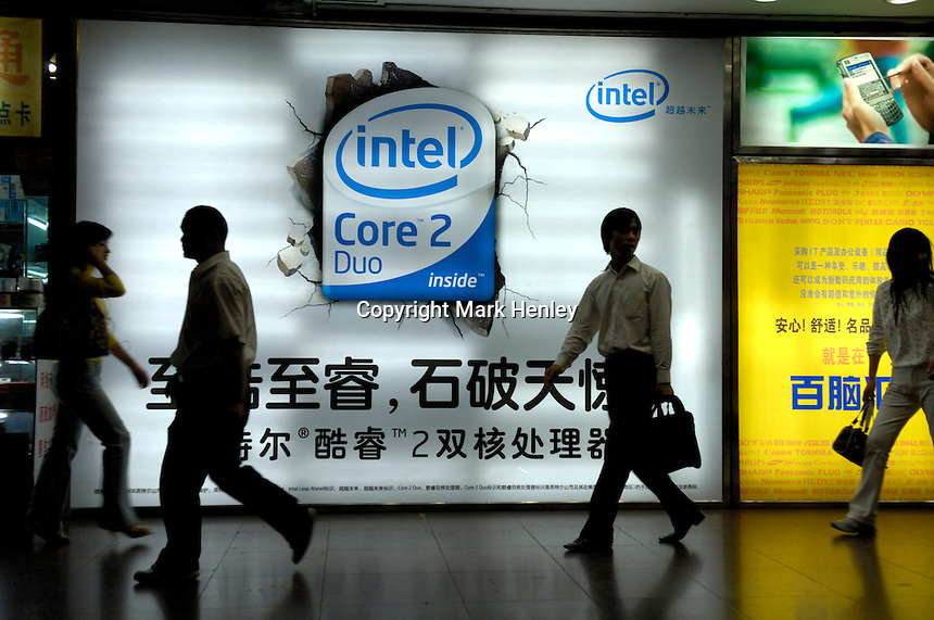 Advertising for chip-maker Intel at the entry to one of Beijing's main computer retail shopping malls in Chaoyang District, China. China is now the world's largest computer hardware producer. .