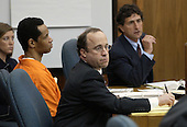 Sniper suspect, John Allen Muhammad, left, listens along with his attorneys Peter Greenspun, center , and Johathan Shapiro, right, during a hearing at the Prince William County Court in Manassas, Virginia, Wednesday, September 10, 2003. The court ruled on several defense motions during the hearing. <br /> Credit: Lawrence Jackson - Pool via CNP
