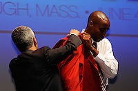 US Soccer President Sunil Gulati helps Hall of Fame inductee Eddie Pope put on the red jacket during the 2011 National Soccer Hall of Fame induction ceremony in Foxborough, MA, on June 04, 2011.