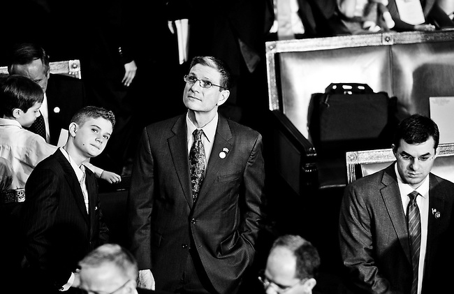 Rep.-elect Joe Heck, R-Nev., and his son Joe look around the House Chamber as the 112th Congress convenes on Wednesday, Jan. 5, 2011.