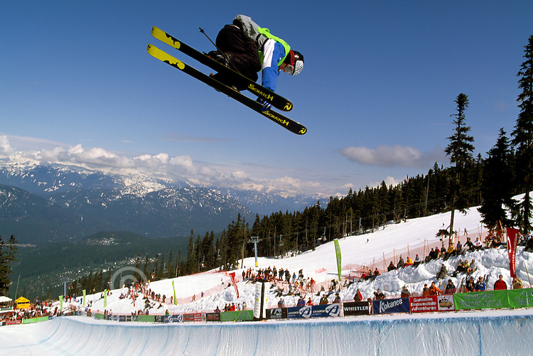 Freestyle Skier competing at the Halfpipe, in the Superpipe Competition on Blackcomb Mountain, Whistler, BC, British Columbia, Canada