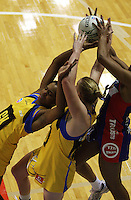 From left: Althea Byfield, Cushla Lichtwark and Pamela Cookey compete for the ball during the ANZ Netball Championship match between the Central Pulse and Northern Mystics, TSB Bank Arena, Wellington, New Zealand on Monday, 4 May 2009. Photo: Dave Lintott / lintottphoto.co.nz