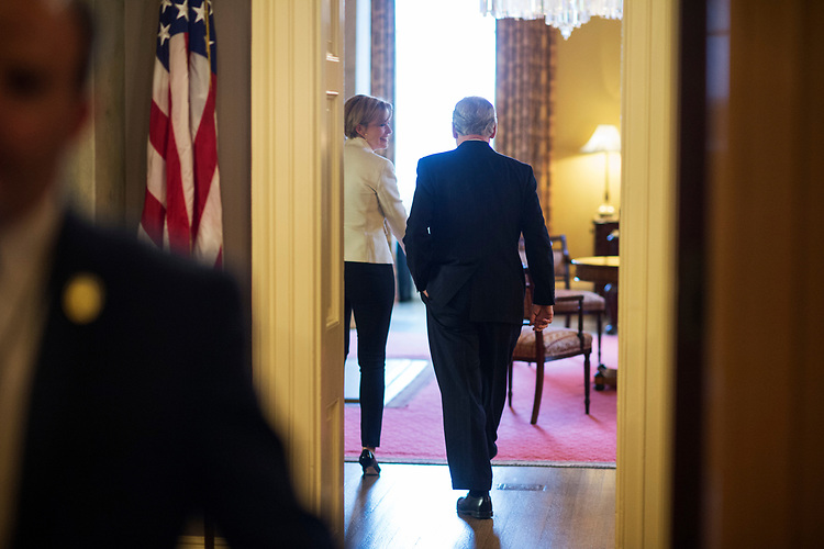 "UNITED STATES - APRIL 6: Senate Majority Leader Mitch McConnell, R-Ky., walks into his office after the Senate invoked the ""nuclear option"" which allows for a majority vote to confirm a Supreme Court justice nominee, April 6, 2017. The vote for nominee Neil Gorsuch is scheduled for Friday. (Photo By Tom Williams/CQ Roll Call)"