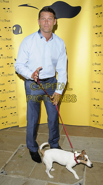 JOHN PARTRIDGE .The Dogs Trust Honours Awards 2010, Jasmine Studios, Shepherd's Bush, London, England..June 3rd, 2010.full length blue shirt trousers leash dog animal pet funny face looks surprised shocked .CAP/CAN.©Can Nguyen/Capital Pictures.
