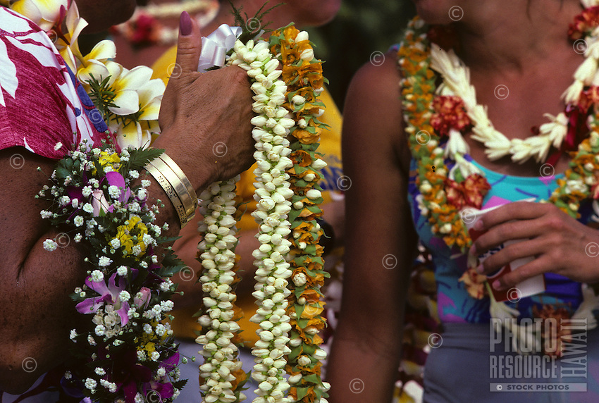 Leis to greet crews at finish of Women's Molokai to Oahu canoe race, Kahanamoku Beach, Waikiki, Oahu.