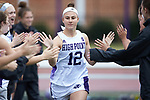 Olivia  Nostrant (12) of the High Point Panthers high fives her teammates during player introductions prior to the match against the North Carolina Tar Heels at Vert Track, Soccer & Lacrosse Stadium on February 16, 2018 in High Point, North Carolina.  The Tar Heels defeated the Panthers 14-10.  (Brian Westerholt/Sports On Film)