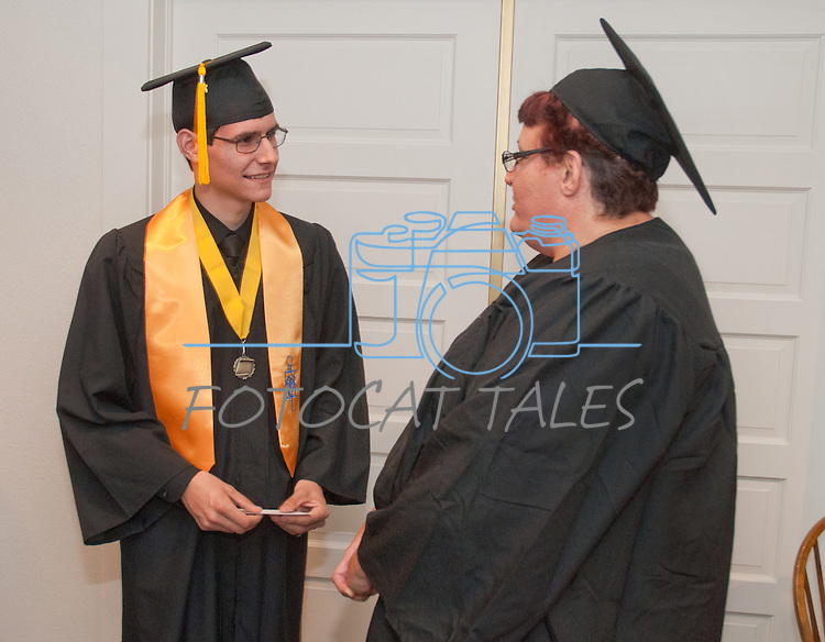 James Clifford, left visits with Micki Foss at the Western Nevada College commencement in Fallon, Nev., on Tuesday, May 20, 2014. <br /> Photo by Kim Lamb