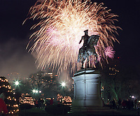 Boston, MA - Fireworks light up the sky behind a statue of a horse-mounted George Washington in Boston Common.