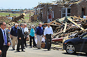 United States President Barack Obama walks with Missouri Governor Jay Nixon as they greet people during a visit to the community that was devastated a week ago by a tornado on May 29, 2011 in Joplin, Missouri. The tornado, which was packing winds of more than 200 mph, is now considered to hold the record for the highest death toll in U.S. history.  .Credit: Joe Raedle / Pool via CNP