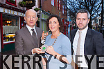 Johnny McGuire outgoing President of the Killarney Chamber of Commerce presents the chain of office to incoming President Kate O'Leary at a ceremony at Market Cross on Saturday incoming vice President Paul O'Neill is also present
