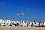 Kite flying above sandy beach at Conil de la Frontera, Cadiz Province, Spain