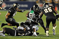 1 September 2011:  FIU linebacker Winston Fraser (34) and defensive back Jonathan Cyprien (7) are joined by defensive end Tourek Williams (97) and linebacker Jordan Hunt  (25) to bring down North Texas running back Lance Dunbar (5) in the second half as the FIU Golden Panthers defeated the University of North Texas, 41-16, at FIU Stadium in Miami, Florida.