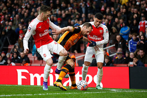 20.02.2016. The Emirates, London, England. Emirates FA Cup 5th Round. Arsenal versus Hull City. David Meyler of Hull shields the ball from Alex Oxlade-Chamberlain and Calum Chambers of Arsenal.