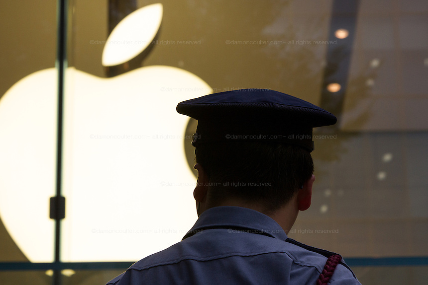 A security guard outside the Apple store in Omotesando before the launch of the iPhone 7 and iPhone 7 plus  in  Tokyo, Japan. Friday September 16th 2016. The iPhone launches are global events. Around 200 eager customers waited outside the Apple store in Tokyo, some for several days, to be first in line to buy the new product.