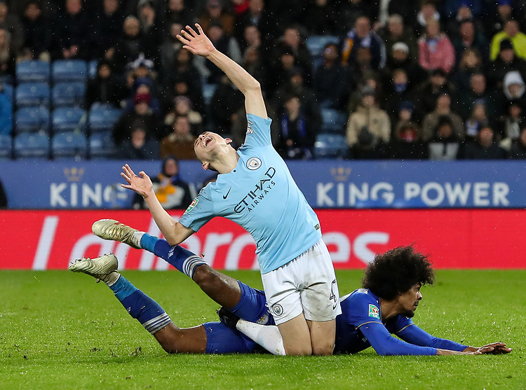 Manchester City 's Phil Foden competing with Leicester City 's Hamza Choudhury<br /> <br /> Photographer Andrew Kearns/CameraSport<br /> <br /> English League Cup - Carabao Cup Quarter Final - Leicester City v Manchester City - Tuesday 18th December 2018 - King Power Stadium - Leicester<br />  <br /> World Copyright © 2018 CameraSport. All rights reserved. 43 Linden Ave. Countesthorpe. Leicester. England. LE8 5PG - Tel: +44 (0) 116 277 4147 - admin@camerasport.com - www.camerasport.com