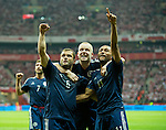 Scotland celebrate the equaliser from Maloney