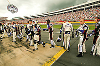 Members of Team Lowe's, the no. 48 Lowe's Chevy Monte Carlo driven by Jimmie Johnson, prepare to start racing again after a brief moment of silence for veterans, held during the 2009 Coca-Cola Classic 600 race at the Lowe's Motor Speedway, in Concord, NC. NASCAR Driver David Reutimann won his first Cup race during the rain-shortened event, held May 25, 2009. NASCAR's longest scheduled race went only 227 laps, or 340.5 miles, before officials ended it because of rain. The 2009 race was the 50th running of the Coca-Cola 600. Ryan Newman and Robby Gordon finished second and third respectively.