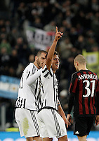 Calcio, Serie A: Juventus vs Milan. Torino, Juventus Stadium, 21 novembre 2015. <br /> Juventus&rsquo; Paulo Dybala, center, is congratulated by his teammate Leonardo Bonucci after scoring the winning goal as AC Milan&rsquo;s Luca Antonelli, right, reacts during the Italian Serie A football match between Juventus and AC Milan at Turin's Juventus stadium, 21 November 2015. Juventus won 1-0.<br /> UPDATE IMAGES PRESS/Isabella Bonotto