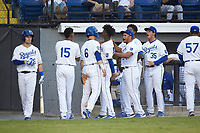 Michael Massey (6) of the Burlington Royals is greeted by teammates after scoring a run during the game against the Johnson City Cardinals at Burlington Athletic Stadium on September 4, 2019 in Burlington, North Carolina. The Cardinals defeated the Royals 8-6 to win the 2019 Appalachian League Championship. (Brian Westerholt/Four Seam Images)