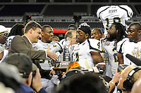 26 December 2010:  FIU wide receiver T.Y. Hilton (4) is awarded the Bowl MVP trophy after the FIU Golden Panthers defeated the University of Toledo Rockets, 34-32, to win the 2010 Little Caesars Pizza Bowl at Ford Field in Detroit, Michigan.