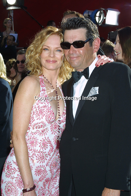 ©2002 KATHY HUTCHINS/ HUTCHINS PHOTO .54th ANNUAL PRIMETIME EMMY AWARDS.SHRINE AUDITIORIUM .LOS ANGELES, CA  9/22/02.MARG HELGENBERGER AND DATE