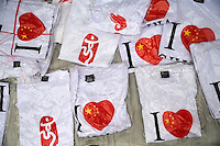 """T-shirts bearing the logo """"I heart China"""" or """"I love China"""" and the 2008 Beijing Olympic logo lay in a pile for sale near the route of the Nanjing, China, leg of the 2008 Olympic Torch Relay.  ."""