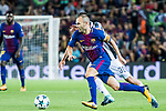 Andres Iniesta Lujan of FC Barcelona is tackled by Rodrigo Bentancur of Juventus during the UEFA Champions League 2017-18 match between FC Barcelona and Juventus at Camp Nou on 12 September 2017 in Barcelona, Spain. Photo by Vicens Gimenez / Power Sport Images