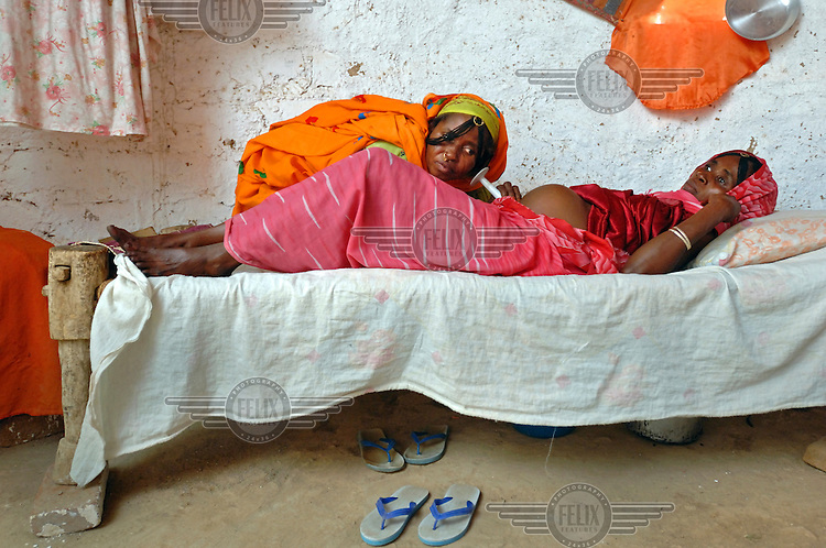 Birth assistant Kadija examines 28 year old Fatna Adem a few days before she is due to give birth. .